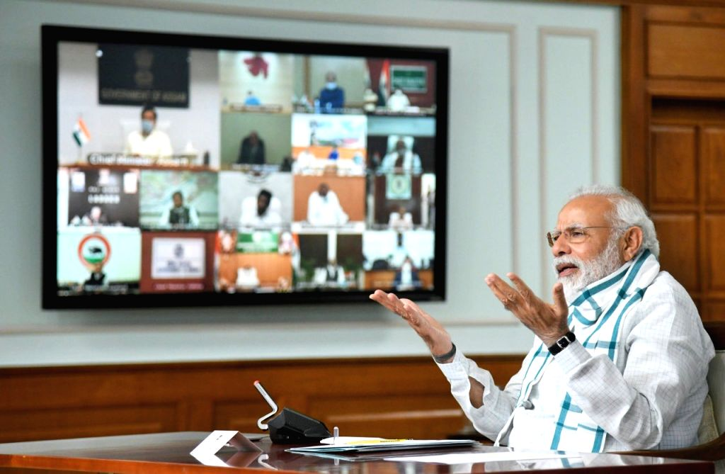 New Delhi: Prime Minister Narendra Modi chairs the 4th interaction with Chief Ministers of all states and Union territories through video conferencing in New Delhi during the extended nationwide lockdown imposed to mitigate the spread of coronavirus; - Narendra Modi
