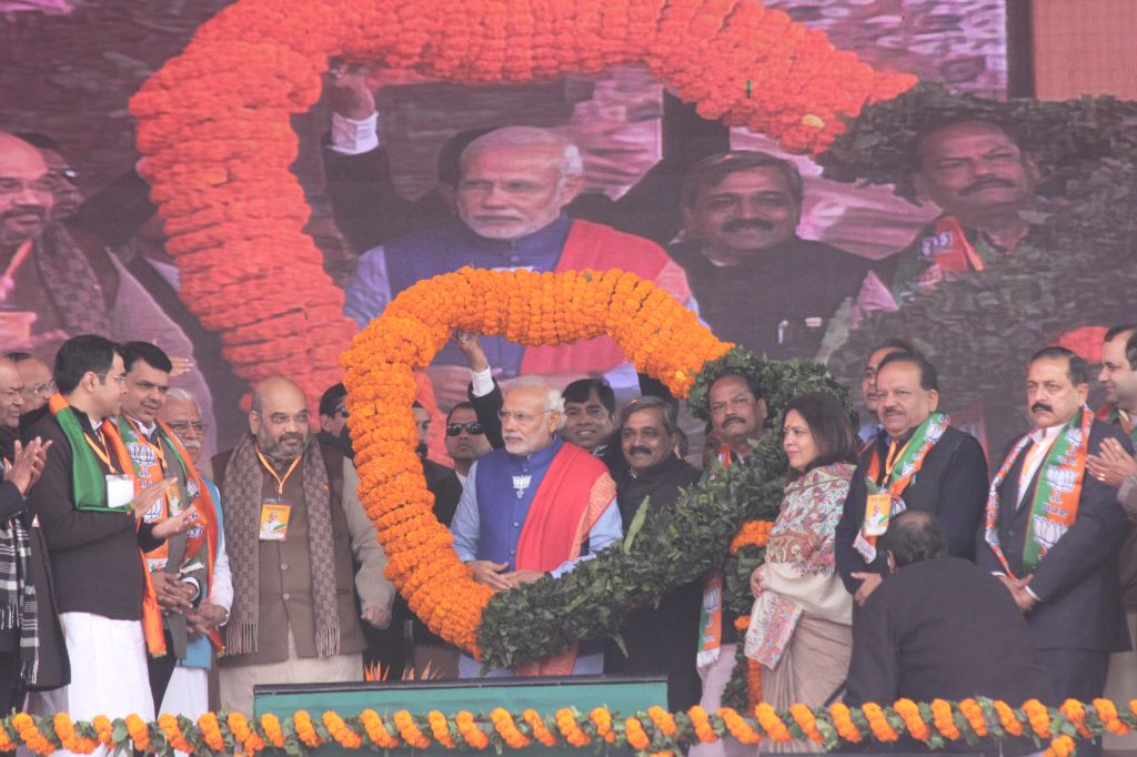 Prime Minister Narendra Modi during a BJP rally to celebrate party's success in the recently concluded assembly polls in Jharkhand and Jammu and Kashmir at Ramlila Maidan in New Delhi on .. - Narendra Modi, M. Venkaiah Naidu, Satish Upadhyay, Amit Shah and Jitendra Singh