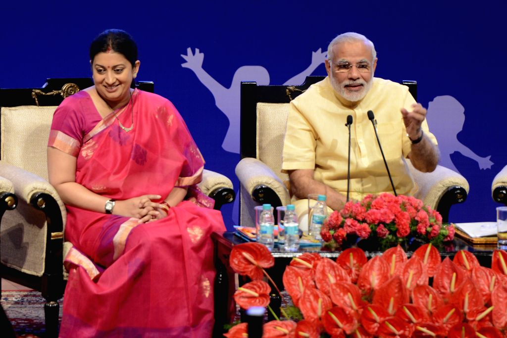 New Delhi: Prime Minister, Narendra Modi during an interaction with school children on eve of the Teachers' Day, at Manekshaw Centre, in New Delhi on Sept. 04, 2015. Union Minister for Human Resource Development, Smriti Irani, the Ministers of State  - Narendra Modi and Smriti Irani