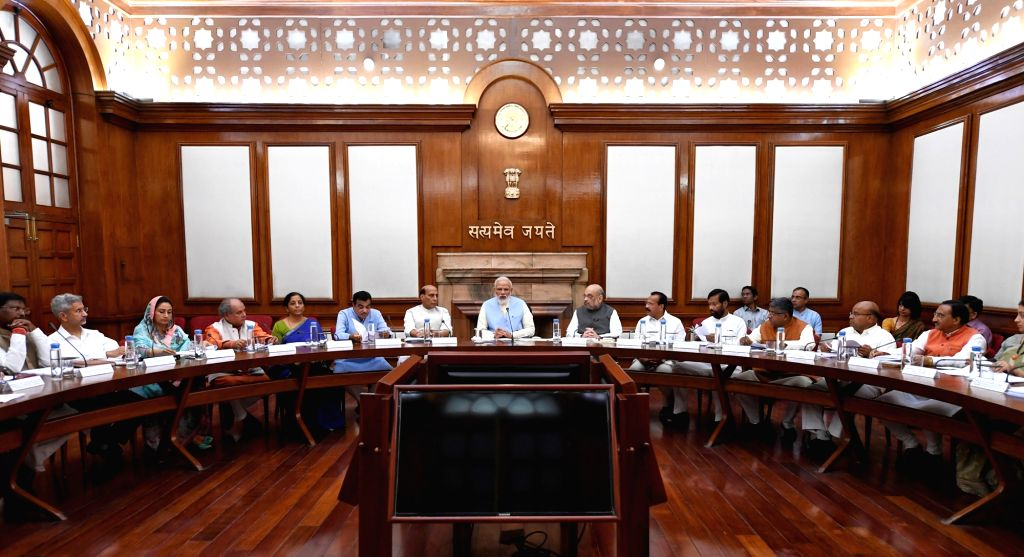 New Delhi: Prime Minister Narendra Modi during the first cabinet meeting at the Prime Minister's Office, in South Block, New Delhi on May 31, 2019. (Photo: IANS/PIB) - Narendra Modi