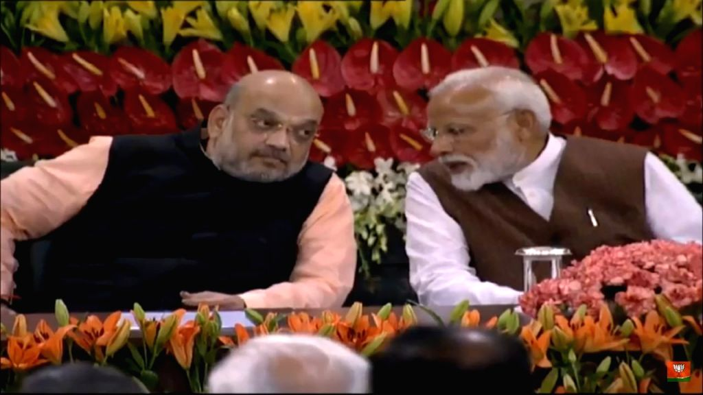 New Delhi: Prime Minister Narendra Modi in a conversation with BJP chief Amit Shah during the NDA Parliamentary Board meeting at Parliament in New Delhi on May 25, 2019. (Photo: IANS) - Narendra Modi and Amit Shah