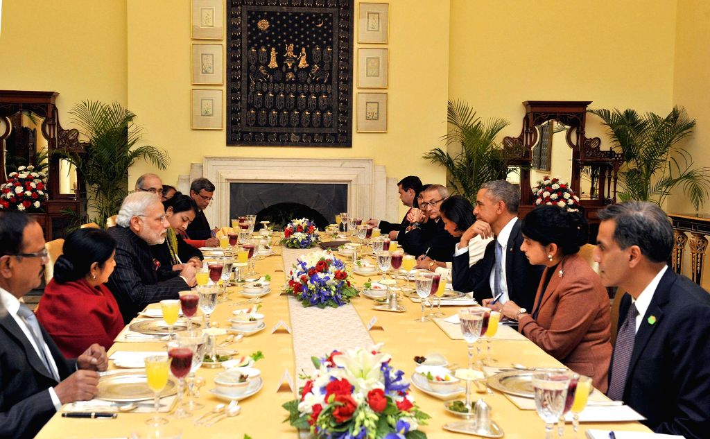 Prime Minister Narendra Modi in the luncheon meeting with the US President Barack Obama, in New Delhi on Jan 25, 2015. Also seen External Affairs Minister Sushma Swara. - Narendra Modi