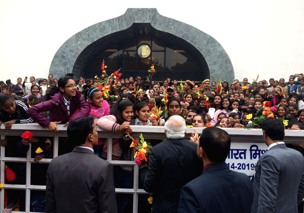 Prime Minister Narendra Modi interacts with people on the New Year's Day, in New Delhi on Jan 1, 2015. - Narendra Modi