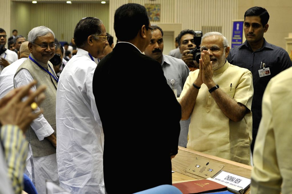 Prime Minister Narendra Modi interacts with the Chief Ministers of different states at the `Joint Conference of Chief Ministers and Chief Justices of High Courts` in New Delhi, on April 5, ... - Narendra Modi