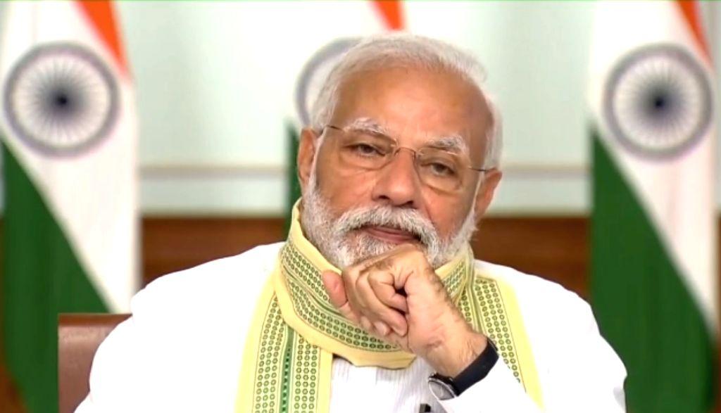 New Delhi: Prime Minister Narendra Modi interacts with Sarpanchs across the country through Video-Conferencing on Panchayati Raj Divas in New Delhi on April 24, 2020. - Narendra Modi