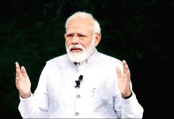 New Delhi: Prime Minister Narendra Modi interacts with students during the 'Pariksha Pe Charcha' Townhall in New Delhi on Jan 20, 2020. (Photo: IANS) - Narendra Modi
