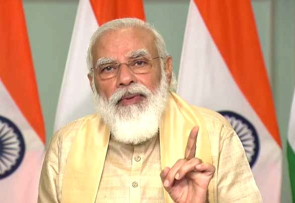 New Delhi: Prime Minister Narendra Modi interacts with the beneficiaries of PM SVANidhi scheme in Madhya Pradesh, via video conferencing from New Delhi on Sep 9, 2020. (Photo: IANS) - Narendra Modi