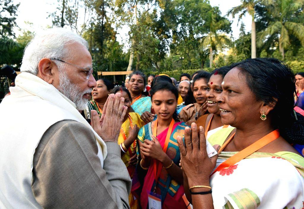 :New Delhi: Prime Minister Narendra Modi interacts with the beneficiaries of the Pradhan Mantri Ujjwala Yojana in New Delhi on Feb 13, 2018. (Photo: IANS/PIB).