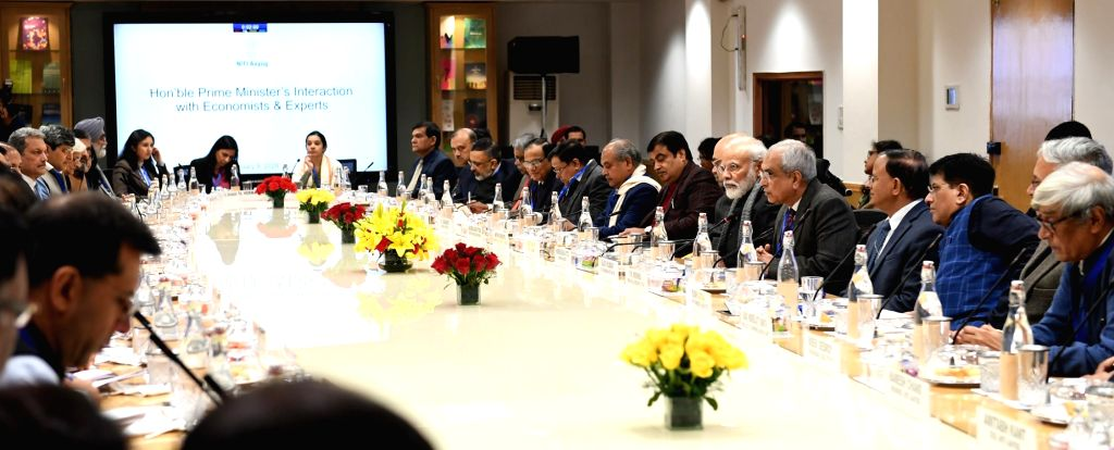 New Delhi: Prime Minister Narendra Modi interacts with the economists and experts in a meeting at the NITI Aayog, in New Delhi on Jan 9, 2020. (Photo: IANS/PIB) - Narendra Modi