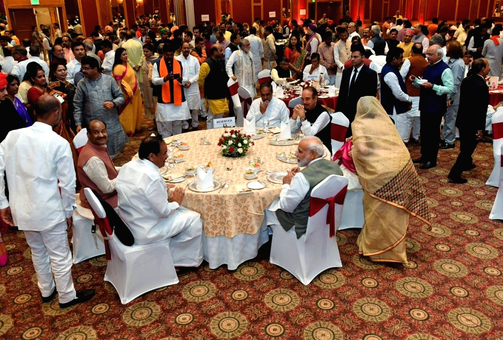 New Delhi: Prime Minister Narendra Modi interacts with Vice President M Venkaiah Naidu at a dinner hosted by him at Ashoka Hotel in New Delhi on June 20, 2019. (Photo: IANS/@narendramodi) - Narendra Modi and M Venkaiah Naidu