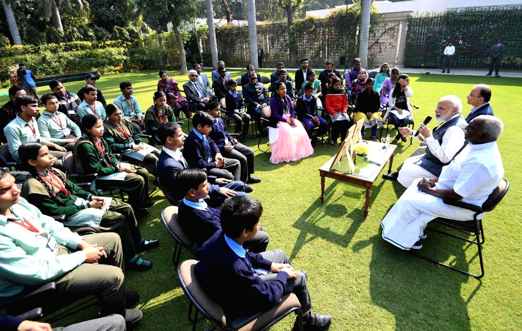 New Delhi: Prime Minister Narendra Modi interacts with visually impaired children during the release of new series of visually impaired friendly circulation coins, in New Delhi, on March 7, 2019. Also seen Union Finance Minister Arun Jaitley and Unio - Narendra Modi and Arun Jaitley
