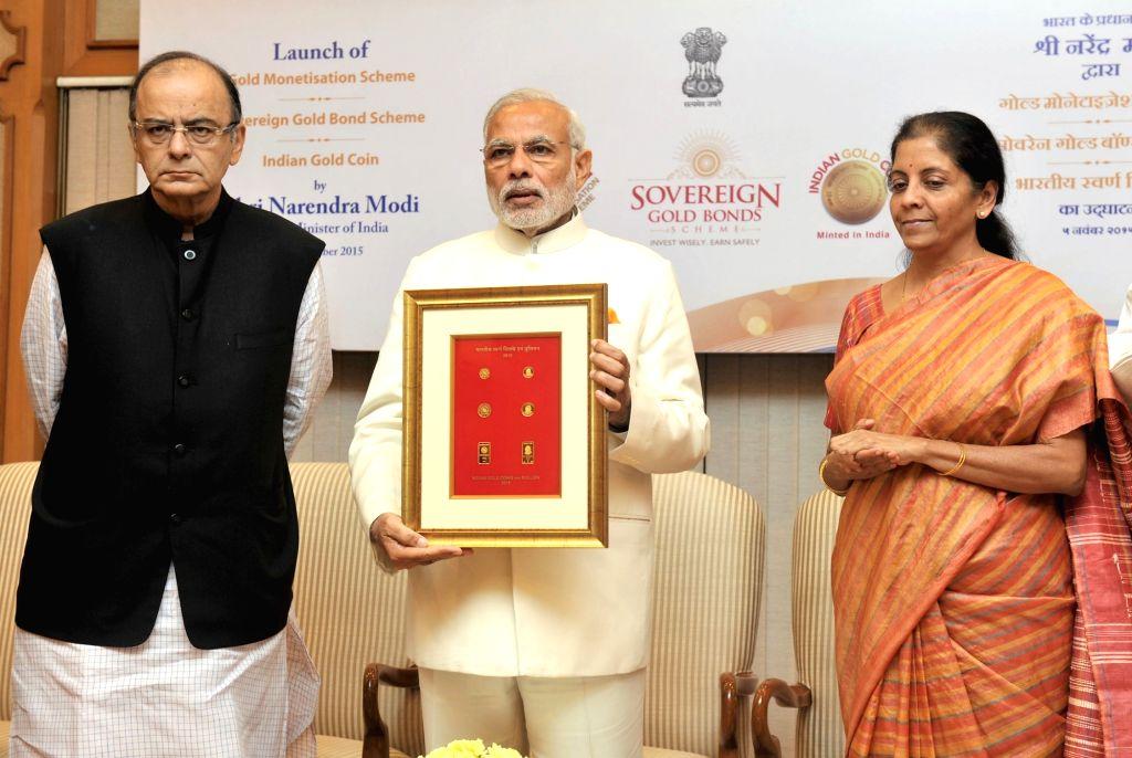:New Delhi: Prime Minister Narendra Modi launches the Gold schemes, in New Delhi on November 05, 2015. The Union Minister for Finance, Corporate Affairs and Information and Broadcasting, Arun ... - Narendra Modi