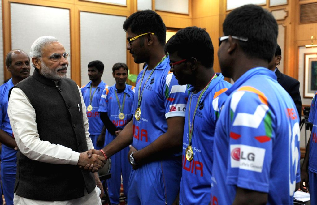 Prime Minister Narendra Modi meets the members of the Indian Blind World Cup Winning Team, in New Delhi on Dec 10, 2014. - Narendra Modi