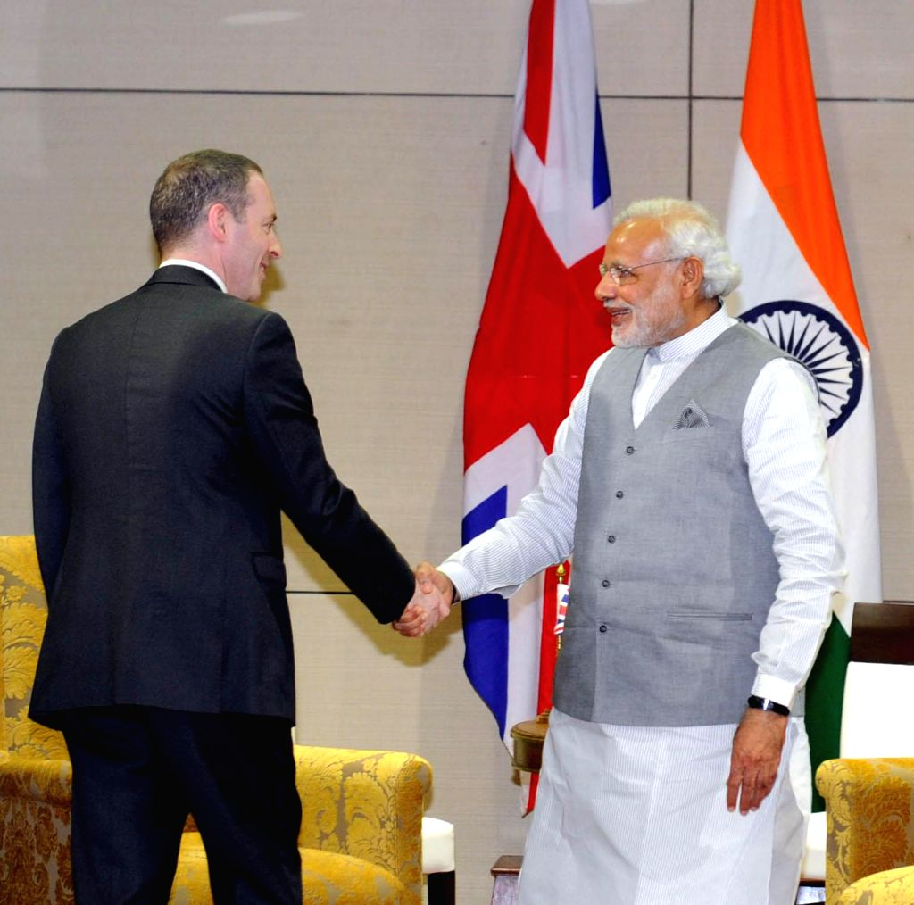 Prime Minister Narendra Modi meets the Minister of State for Trade & Investment of UK, Lord Ian Livingston, at New Sachivalaya, in Gandhinagar, Gujarat on Jan 10, 2015. - Narendra Modi