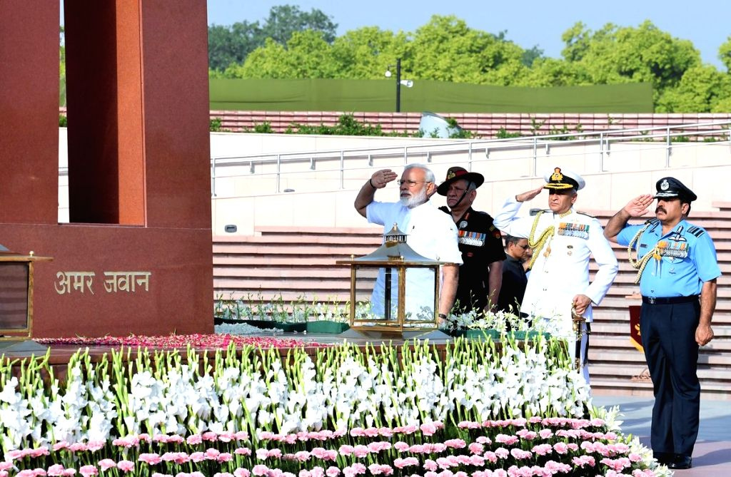 New Delhi: Prime Minister Narendra Modi pays homage to fallen soldiers at the National War Memorial, ahead of his swearing-in ceremony later in the day, in New Delhi, on May 30,2019. Also seen Chief of Army Staff, General Bipin Rawat, Chief of Naval  - Narendra Modi