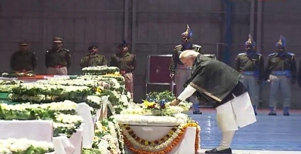 New Delhi: Prime Minister Narendra Modi pays tribute to CRPF personnel who were killed in a suicide attack by militants in Jammu and Kashmir's Pulwama district on 14th Feb 2019; at Palam Airport in New Delhi on Feb 15, 2019. (Photo: IANS/BJP) - Narendra Modi