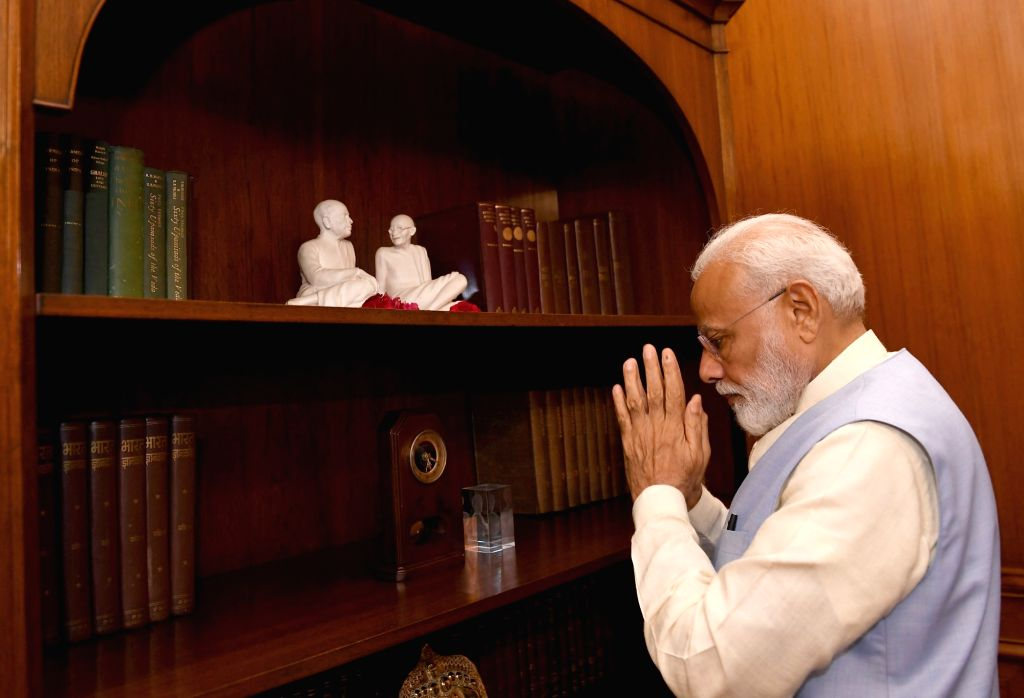 New Delhi: Prime Minister Narendra Modi pays tributes to Mahatma Gandhi and Sardar Patel at the Prime Minister's Office in South Block, in New Delhi on May 31, 2019. (Photo: IANS/PIB) - Narendra Modi and Sardar Patel
