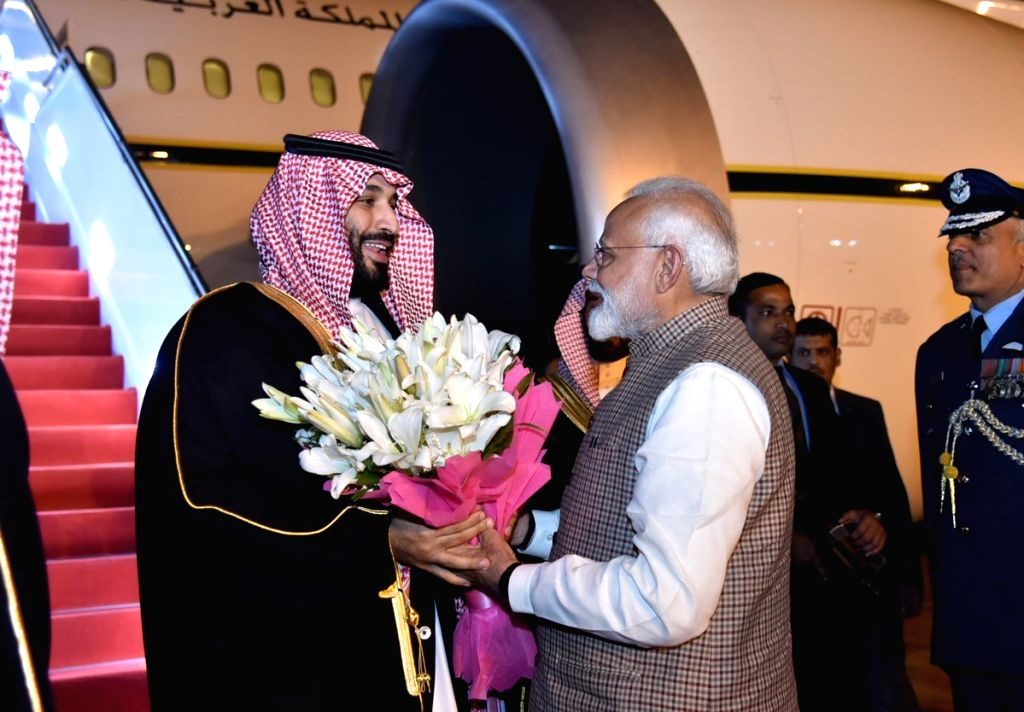 New Delhi: Prime Minister Narendra Modi receives Saudi Crown Prince Mohammad Bin Salman on his arrival at Palam Airport in New Delhi on Feb 19, 2019. (Photo: IANS/PIB) - Narendra Modi