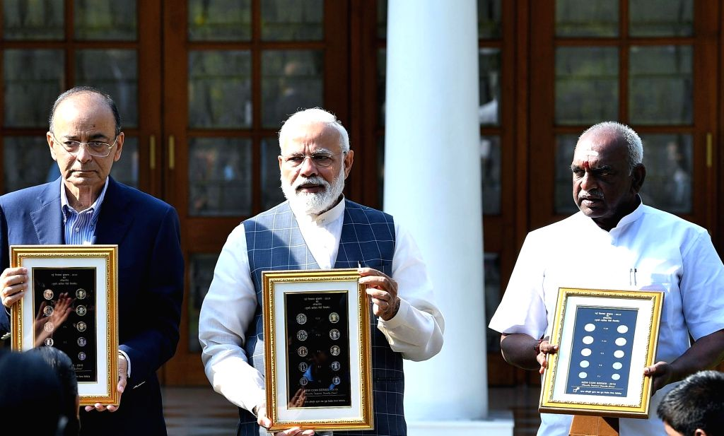New Delhi: Prime Minister Narendra Modi releases the new series of visually impaired friendly circulation coins, in New Delhi, on March 7, 2019. Also seen Union Finance Minister Arun Jaitley and Union MoS Finance P. Radhakrishnan. (Photo: IANS/PIB) - Narendra Modi and Arun Jaitley
