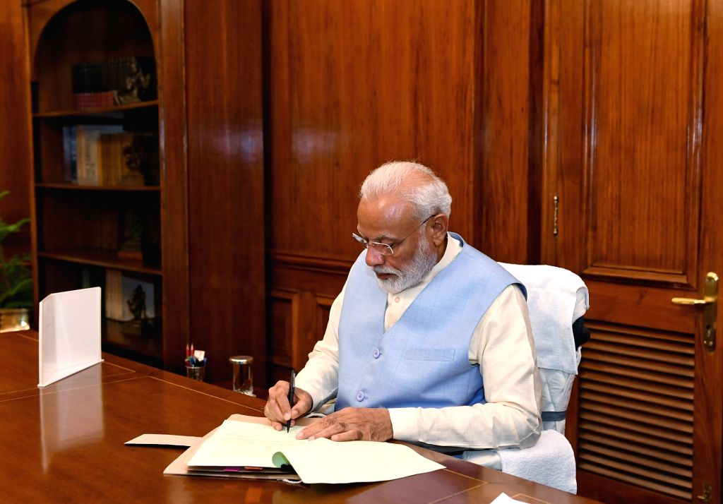 New Delhi: Prime Minister Narendra Modi takes charge of the office of the Prime Minister of India at South Block, in New Delhi on May 31, 2019. (Photo: IANS/PIB) - Narendra Modi