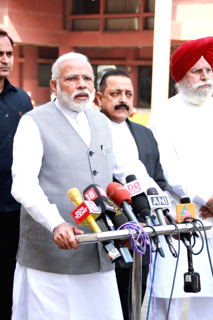 : New Delhi: Prime Minister Narendra Modi talks to press ahead of the second phase of Budget Session of the Parliament, in New Delhi on March 9, 2017. Also seen the Minister of State for Development ...
