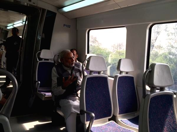 Prime Minister Narendra Modi travels in Delhi metro on April 25, 2015. Modi travelled from Dhaula Kuan to Dwarka and shared a picture on social networking site Twitter. - Narendra Modi