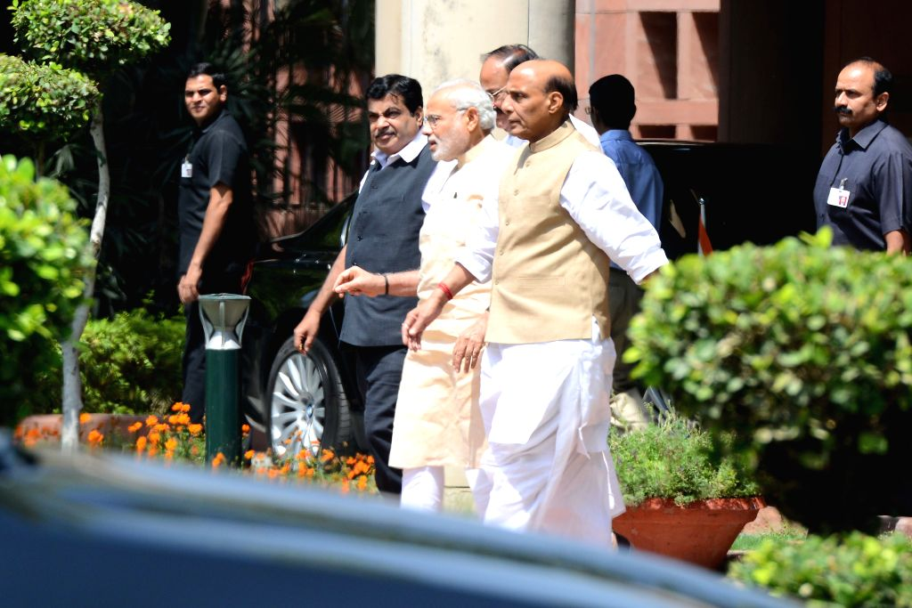 Prime minister Narendra Modi, Union Home Minister Rajnath Singh and the Union Minister for Road Transport and Highways, and Shipping Nitin Gadkari at the Parliament in New Delhi on May 5, ... - Narendra Modi and Rajnath Singh