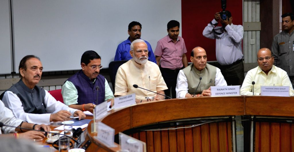 New Delhi: Prime Minister Narendra Modi, Union Ministers Pralhad Joshi, Rajnath Singh and Thawar Chand Gehlot along with Congress leader Ghulam Nabi Azad during the all party meeting in New Delhi, on June 16, 2019. (Photo: IANS) - Narendra Modi, Ministers Pralhad Joshi, Rajnath Singh and Thawar Chand Gehlot