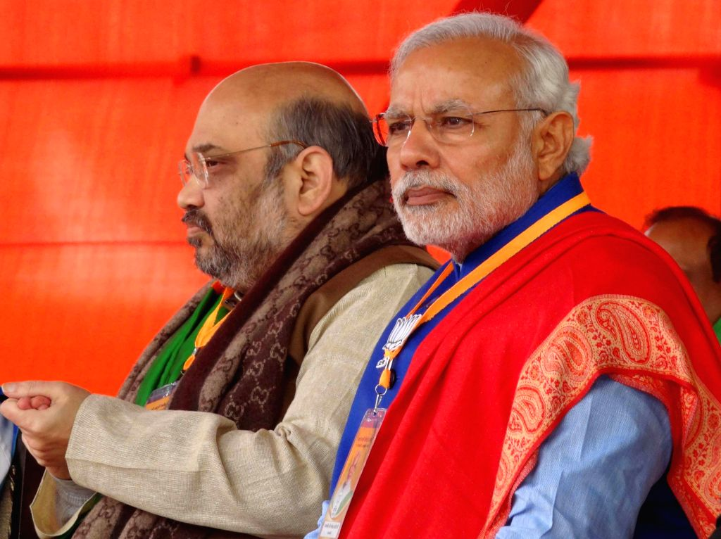 Prime Minister Narendra Modi with BJP chief Amit Shah during a BJP rally to celebrate party's success in the recently concluded assembly polls in Jharkhand and Jammu and Kashmir at Ramlila - Narendra Modi and Amit Shah