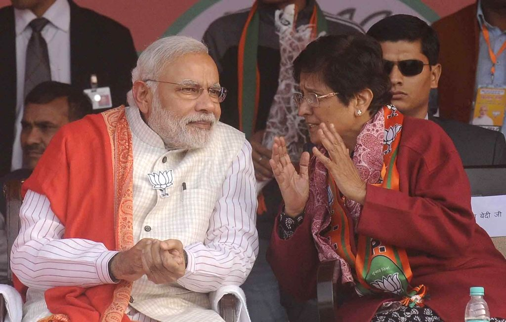 Prime Minister Narendra Modi with BJP's Chief Ministerial candidate for Delhi Kiran Bedi during a Delhi Assembly Election rally in New Delhi on Feb. 4, 2015. - Narendra Modi and Kiran Bedi