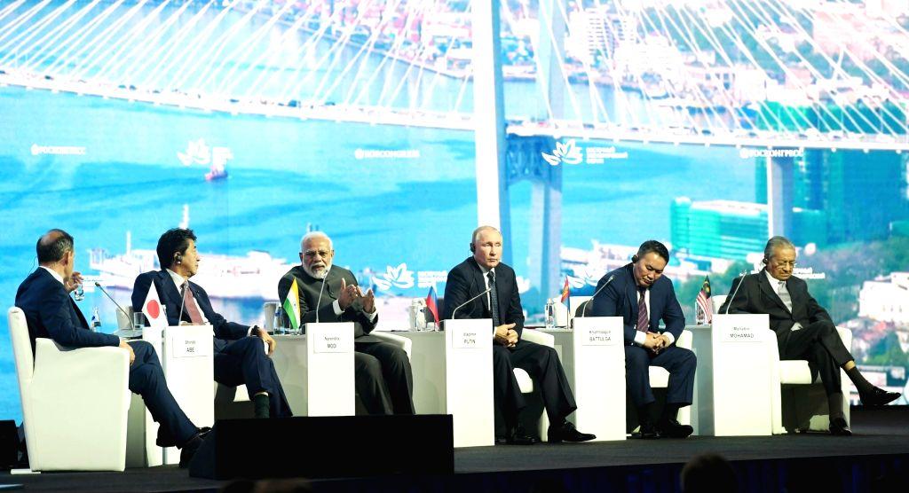 New Delhi: Prime Minister Narendra Modi with Japanese Prime Minister Shinzo Abe, Russian President Vladimir Putin, Mongolian President Khaltmaagiin Battulga and Malaysian Prime Minister Mahathir Bin Mohamad at the Eastern Economic Forum (EEF) 2019 in - Narendra Modi