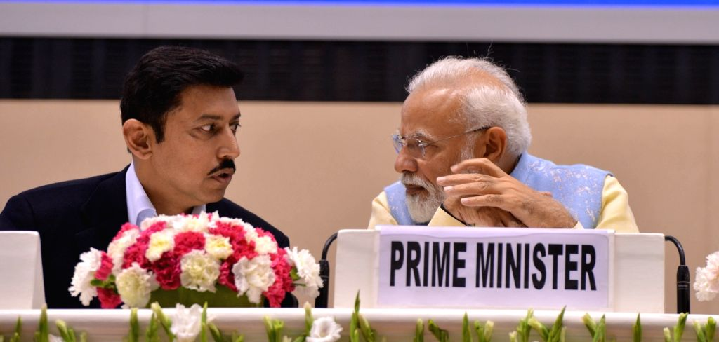 New Delhi: Prime Minister Narendra Modi with Rajyavardhan Singh Rathore, Union Minister of State for Ministry of Youth Affairs and Sports at the National Youth Parliament Festival 2019 at Vigyan Bhawan in New Delhi on Feb. 27, 2019. (Photo: IANS) - Narendra Modi and Rajyavardhan Singh Rathore
