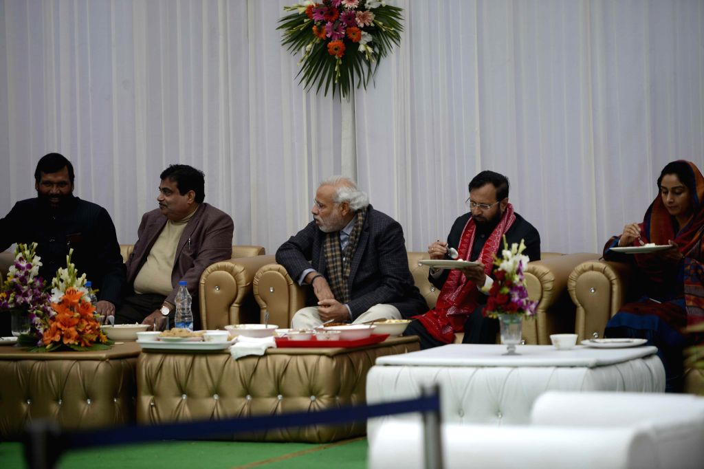 Prime Minister Narendra Modi with the Union Minister for Road Transport and Highways, and Shipping, Nitin Gadkari, the Union Minister of State for Environment, Forest and Climate Change ... - Narendra Modi