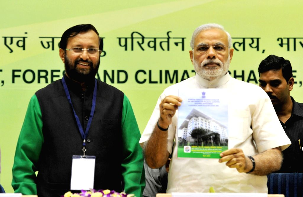 Prime Minister Narendra Modi with the Union Minister of State for Environment, Forest and Climate Change (Independent Charge) Prakash Javadekar addresses at the Conference of State ... - Narendra Modi