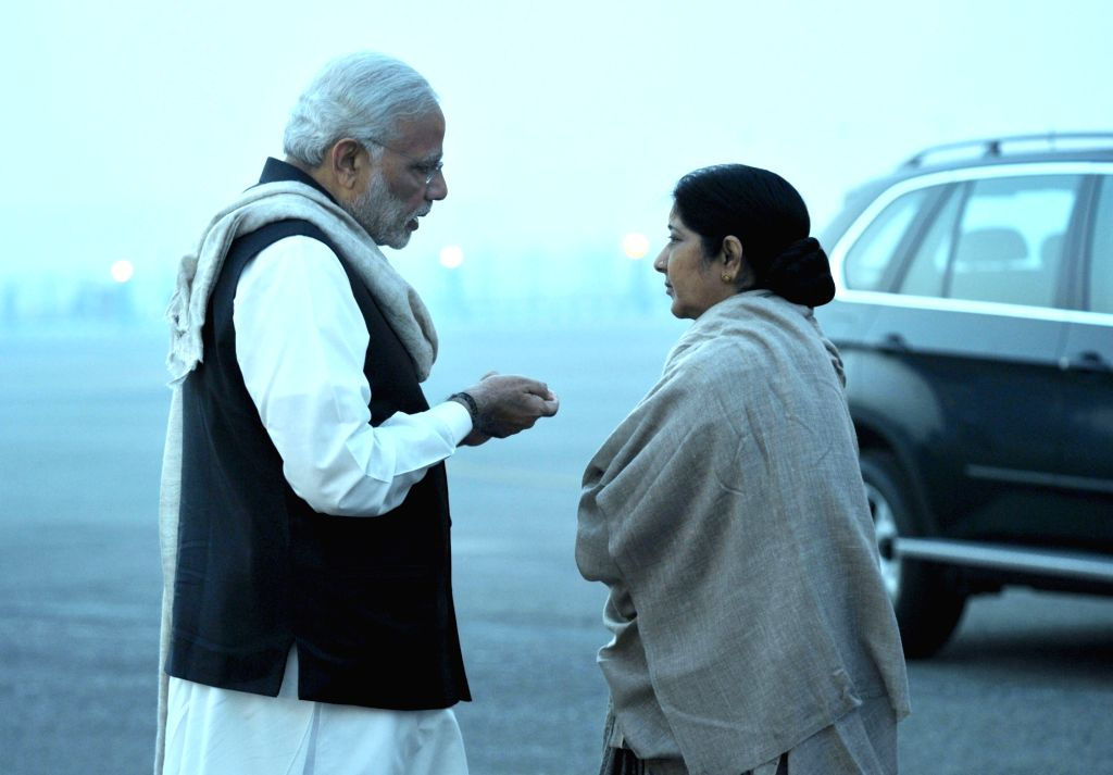 : New Delhi: Prime Minister Narendra Modi with Union Minister for External Affairs and Overseas Indian Affairs Sushma Swaraj before leaving for UK and Turkey, in New Delhi on Nov 12, 2015. (Photo: ...