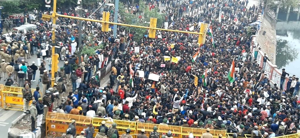 New Delhi: Protesters gather in large numbers amid heavy police deployment during protests organised to show solidarity with Jamia Students and against the Citizenship Amendment Act (CAA) 2019 which is the latest flash point in the country, in North
