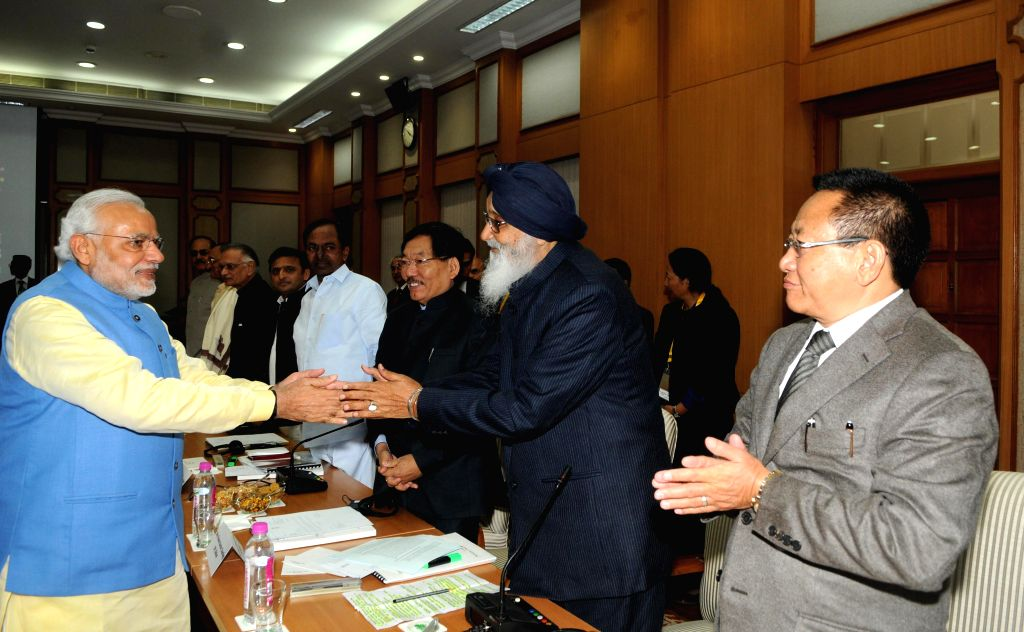 Punjab Chief Minister Parkash Singh Badal shakes hands with Prime Minister  Narendra Modi during a meeting regarding Restructuring of Planning Commission of India in New Delhi, on Dec 7, .. - Parkash Singh Badal and Narendra Modi