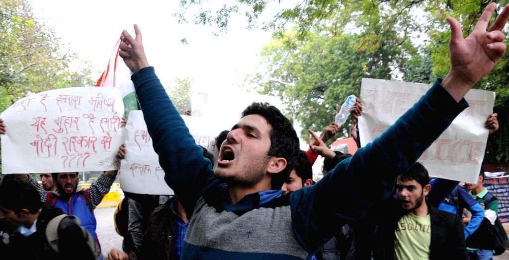 Punjab Technical University (PTU) students hailing from Jammu and Kashmir stage a demonstration at Jantar Mantar to press for 100% scholarship in New Delhi, on March 3, 2015.