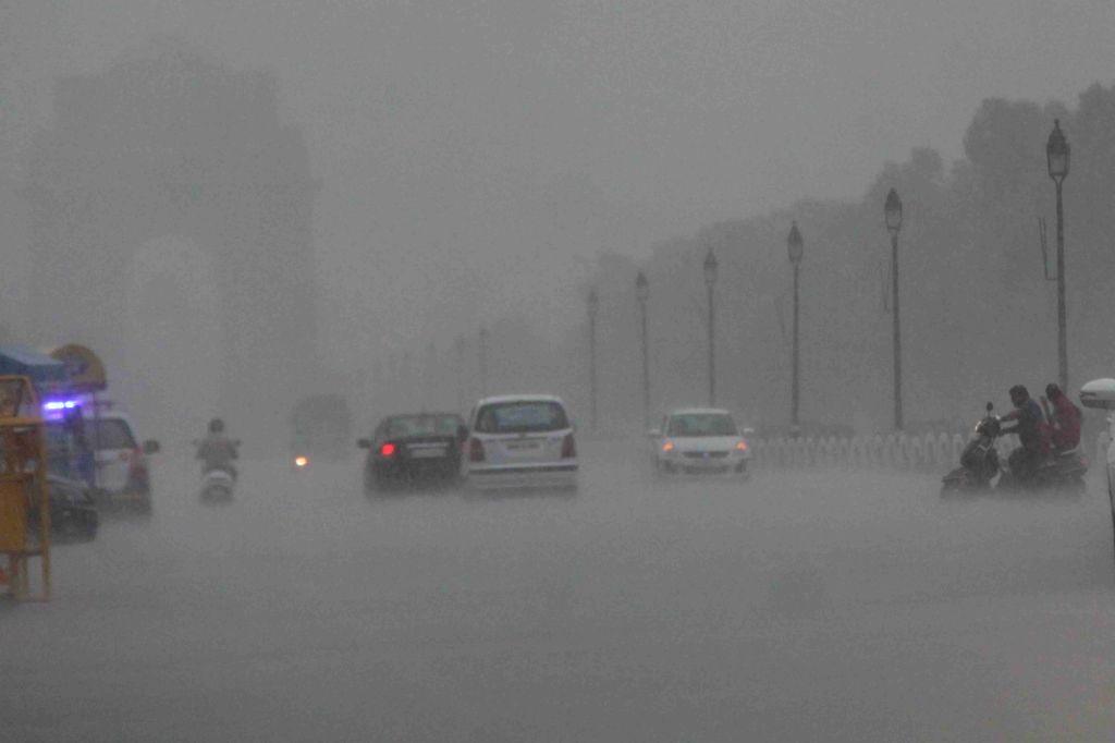 New Delhi: Rains lash New Delhi on July 15, 2019. (Photo: Bidesh Manna/IANS)