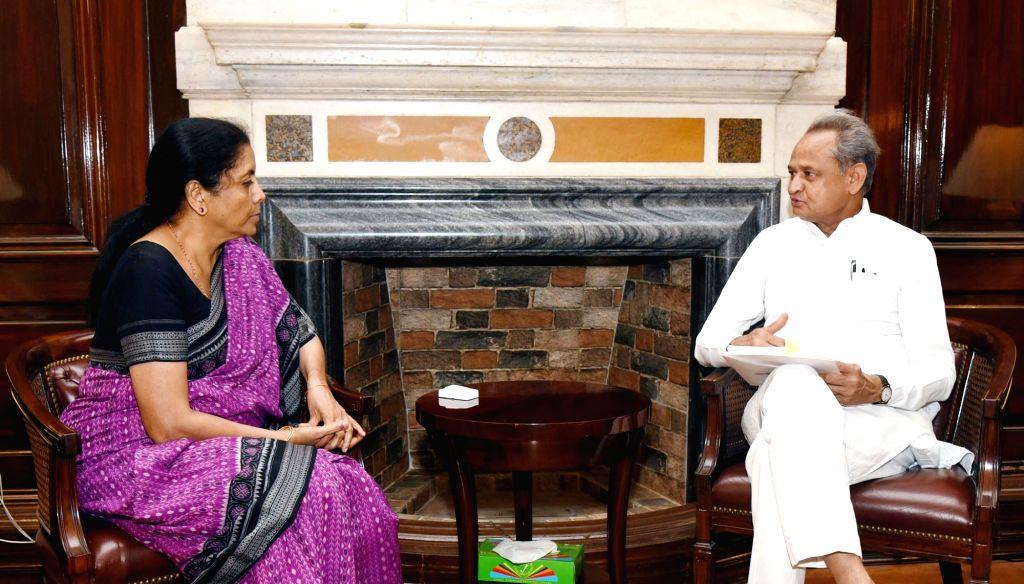 New Delhi: Rajasthan Chief Minister Ashok Gehlot meets Union Finance and Corporate Affairs Minister Nirmala Sitharaman, in New Delhi on June 15, 2019. (Photo: IANS/PIB) - Ashok Gehlot