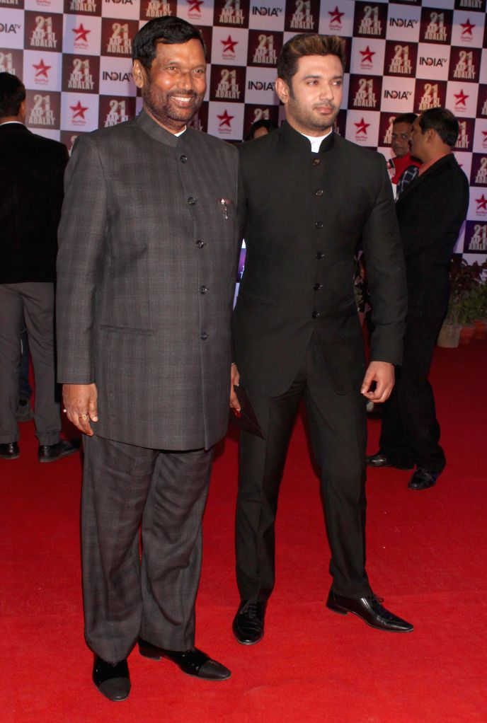 Ram Vilas Paswan and Chirag Paswan during a programme organised to celebrate 21 years of a `Aap Ki Adalat` a TV show at Pragati Maidan in New Delhi on Dec 2, 2014.