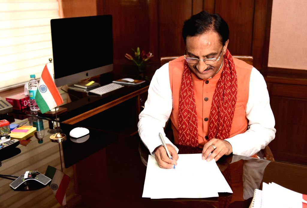 New Delhi: Ramesh Pokhriyal 'Nishank' takes charge as the Union Minister for Human Resource Development, in New Delhi on May 31, 2019. (Photo: IANS/PIB)