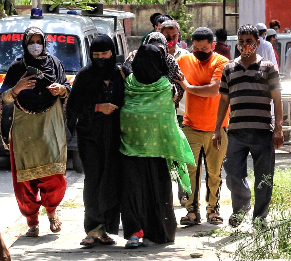New Delhi: Relative of a coronavirus victim mourns outside a mortuary of a COVID-19 hospital (GTB) in New Delhi on Monday, 03 May 2021.(Photo: Wasim Sarvar/IANS)