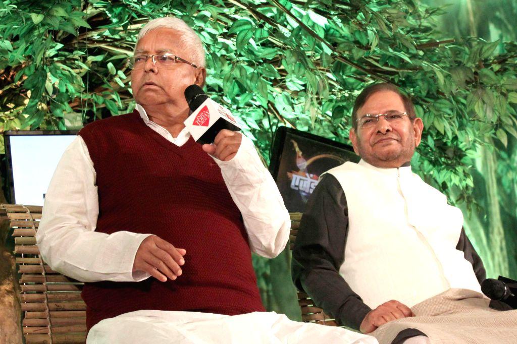 RJD supremo Lalu Prasad Yadav, JD(U) chief Sharad Yadav and during a programme organised by Aaj Tak in New Delhi, on Dec 12, 2014. 