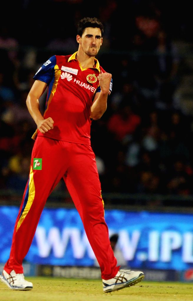 Royal Challengers Bangalore player Mitchell Starc celebrates fall of a wicket during an IPL -2015 match between Delhi Daredevils and Royal Challengers Bangalore at Feroz Shah Kotla Stadium ...