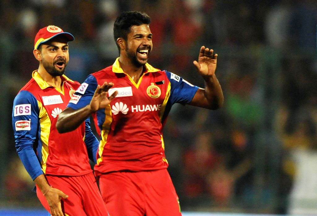Royal Challengers Bangalore players celebrate fall of a wicket during an IPL -2015 match between Delhi Daredevils and Royal Challengers Bangalore at Feroz Shah Kotla Stadium in New Delhi, ...