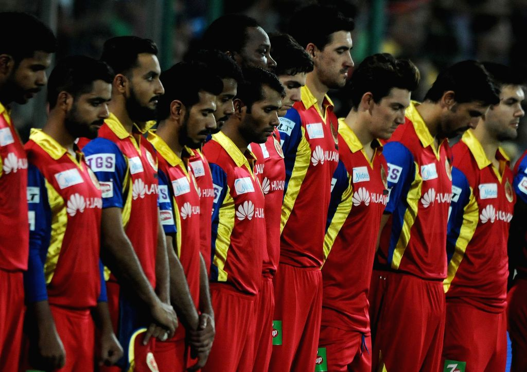 Royal Challengers Bangalore players pay tribute to the victims of Nepal earthquake ahead of an IPL -2015 match between Delhi Daredevils and Royal Challengers Bangalore at Feroz Shah Kotla ... - Feroz Shah Kotla