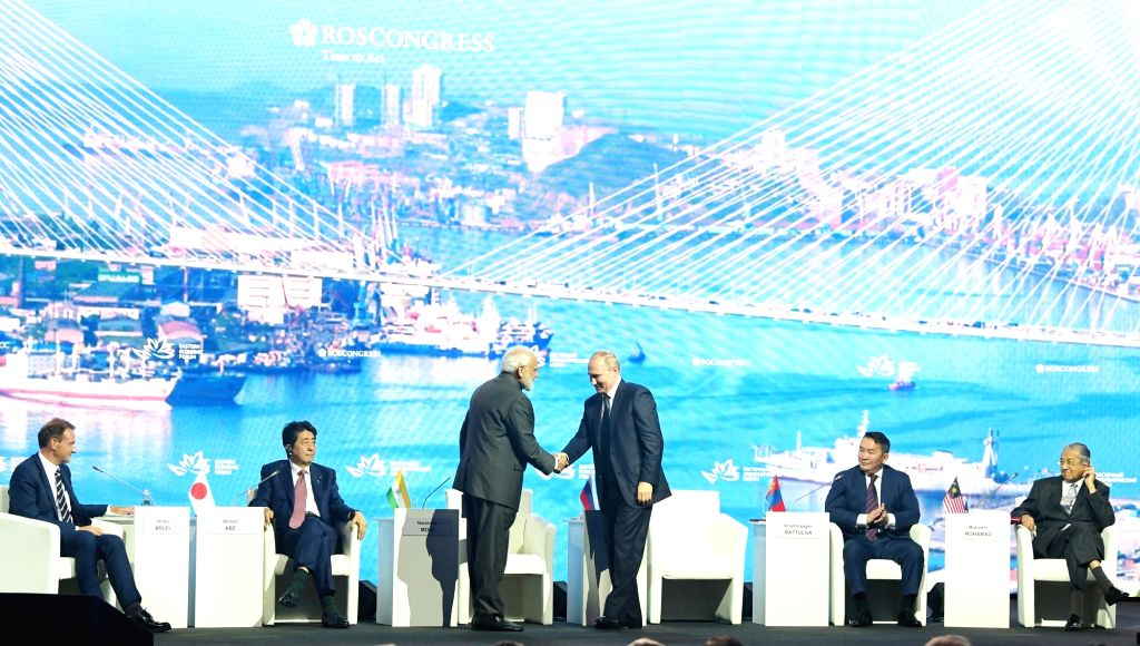 New Delhi: Russian President Vladimir Putin greets Prime Minister Narendra Modi at the Eastern Economic Forum (EEF) 2019 in Vladivostok, Russia on Sep 5, 2019. Also seen Japanese Prime Minister Shinzo Abe, Mongolian President Khaltmaagiin Battulga an - Narendra Modi