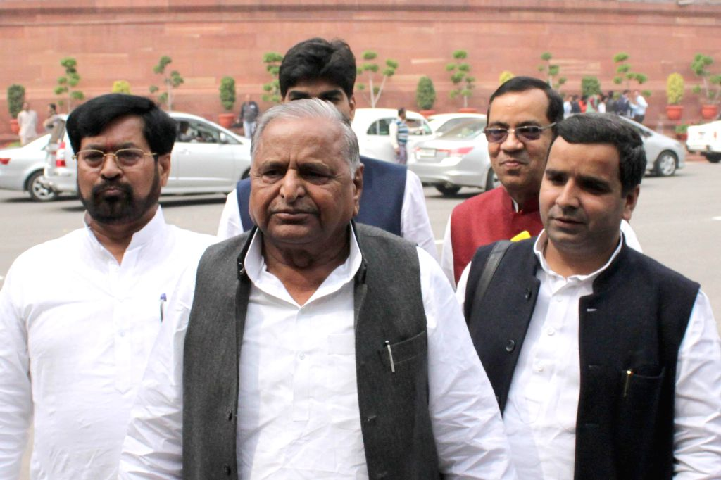 Samajwadi Party chief Mulayam Singh and others at the Parliament on the second day of the budget session in New Delhi, on Feb 24, 2015. - Mulayam Singh