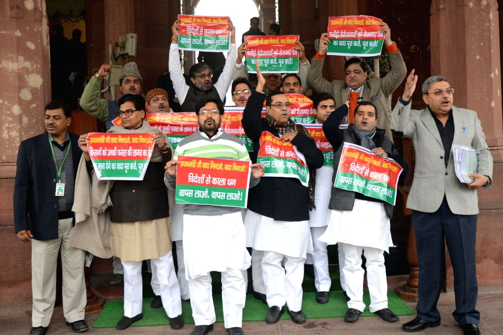 Samajwadi Party leader Ram Gopal Yadav and others stage a protest against Narendra Modi led Union Government at the Parliament House, in New Delhi on Dec 22,2014. - Gopal Yadav